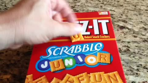 Taking crackers from a box without opening it