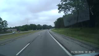 Pop-Up Camper Pops its Top on Expressway - Video