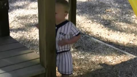 Kid Laughs So Hard At His Dad That He Falls Off Playground Equipment