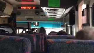 Man on bus rocks back and forth