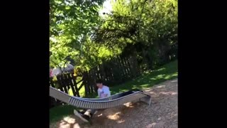 Guy in white shirt falls off silver slide - Video