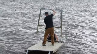 Dock Collapses Into Lake - Video