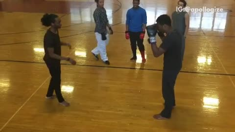 Two guys boxing in basketball court gymnasium