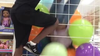 Reckless Teens Climb Toy Store Ball Cage And Get Trapped Inside - Video