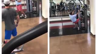 Man in pink shorts funny gym workout - Video