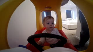 GoPro captures toddler's epic car drift through kitchen - Video