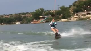 Collab copyright protection - young girl water skis belly flop - Video