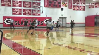 Student in grey shirt falls during basketball game  - Video