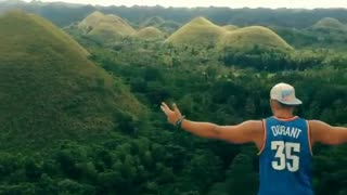 Guy gets crazy by the Chocolate hills in Bohol - Video