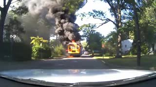 Hero bus driver rescues 20 children from burning school bus - Video