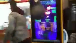 Guy jean jacket misses weak punch punching bag game - Video