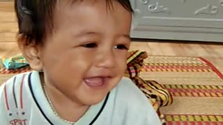The baby laughs look very cute  - Video
