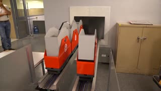 New York Library now uses tiny trains to transport its books - Video