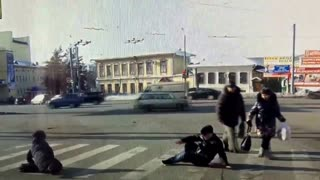 Strangers Trip Over Each Other While Crossing the Street - Video