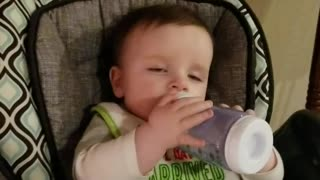 Baby falls asleep drinking his bottle