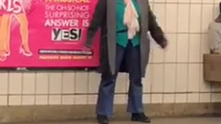 Woman waiting for subway clapping above head - Video