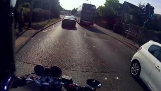 Cyclist Hits Pedestrian at Red Light - Video
