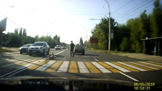 Cyclist Crashes into Car at Crossing