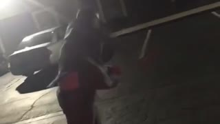 Guy in grey suit dancing and throwing glass bottle parking lot - Video