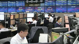 More losses in Shangai but other Asia markets gain - Video