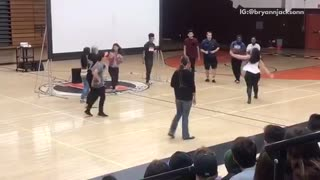 Dance circle gym guy flips friend over back