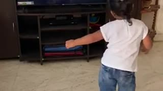 Girl watching TV dance and tipping Video