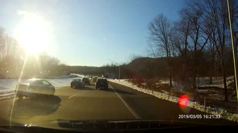 Cars nearly collide on highway lane merge