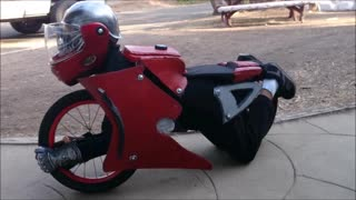 Boy 'Transforms' Into A Motorcycle With His Halloween Costume - Video