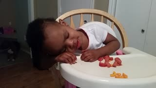 Adorable baby girl falls asleep while eating - Video
