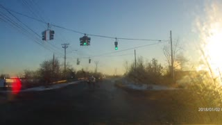 Dashcam captures red light runner  - Video