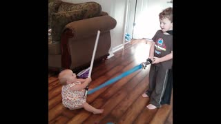 Brother versus baby lightsaber duel
