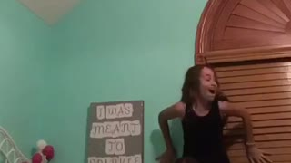 Girls try to do piggy back ride on bed fall into window - Video