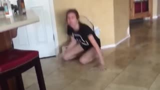 Girl hoverboards into wall - Video