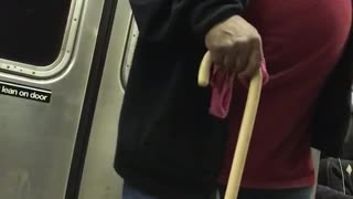 Guy red shirt cane dancing singing subway