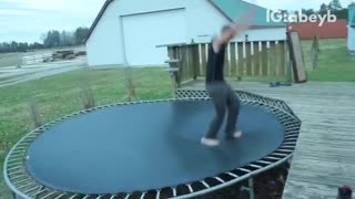 Man does handstand off trampoline and falls off