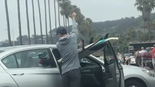 Guy in silver car surf board passenger seat - Video