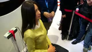 Mood sensing robot unveilied in Beijing - Video