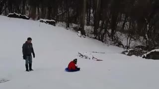 Red jacket toddler snow hill flip - Video