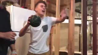 White shirt kid in basement dunks on shooting game basketball - Video