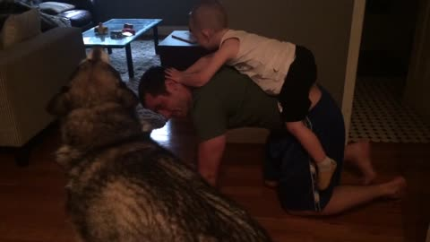 Cute moment between dog, dad and son