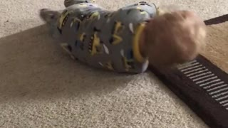 Cute baby rolling all over  - Video