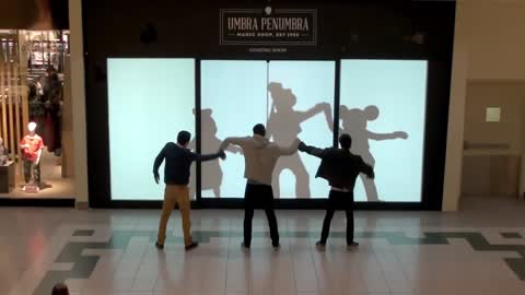 Disney characters challenge shoppers to dance battle