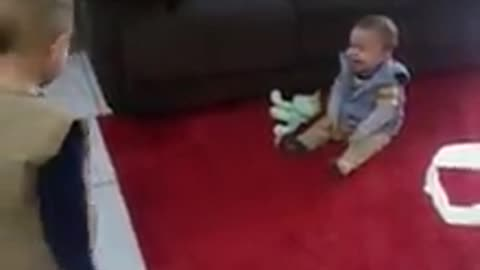Baby boy can't stop laughing at big brother's antics