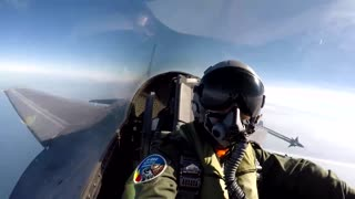 Pilot in F-16 fighter jet takes high-altitude selfies - Video