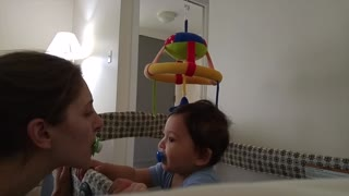 Baby exchanges pacifiers with mommy - Video