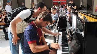 Two Perfect Strangers Improvise A Piano Duet At Paris Train Station - Video