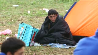Tent burns at Hungary migrant camp as more arrive