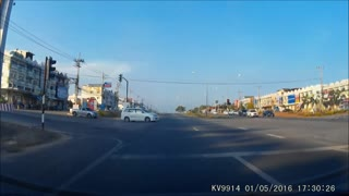 Good Reflexes Save A Motorcyclist From Head-On Collision  - Video