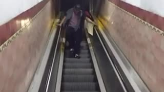 Man falls on escalator  - Video
