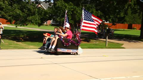 Motorized couch and 4th of July Parade.